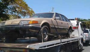 Truck towing car for free